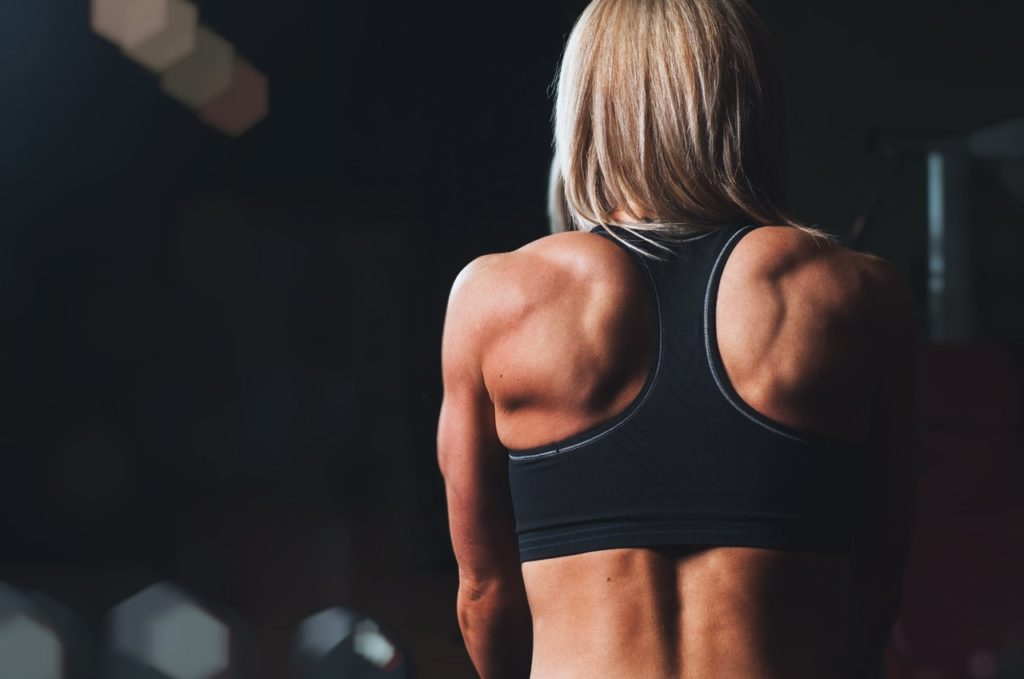 Woman showing her back muscles